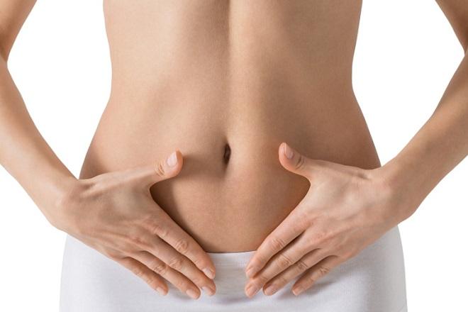 massage vùng bụng dưới chữa tắc vòi trứng