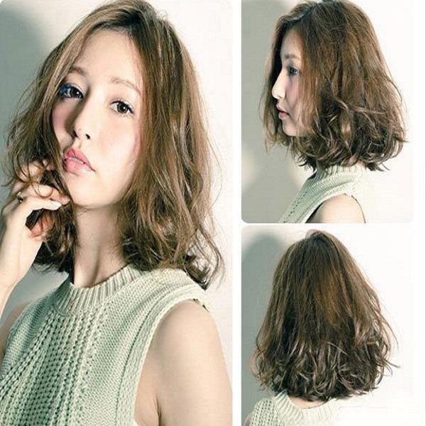 tóc uốn ngắn cho mặt tròn